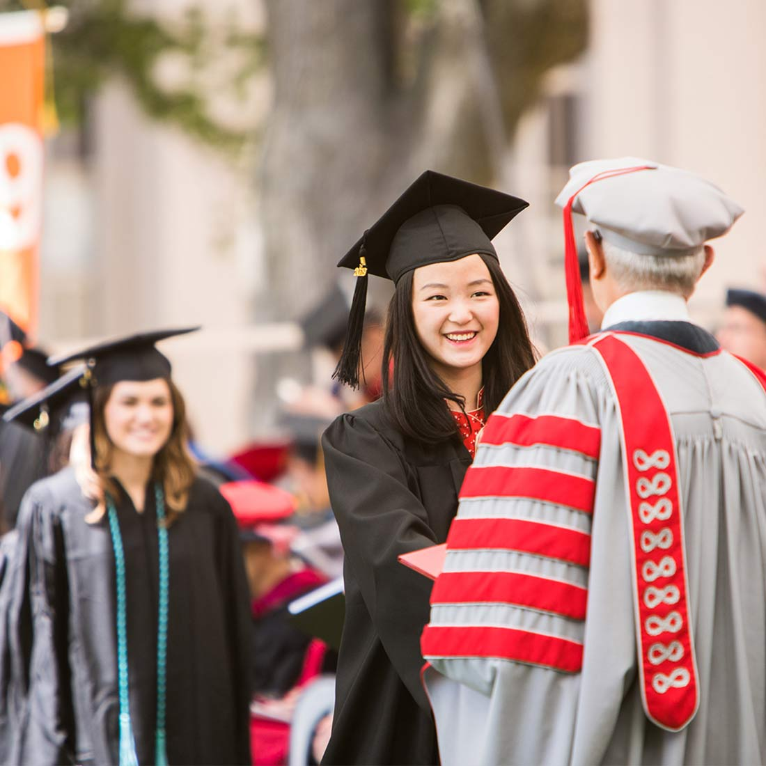 A student receives her degree from MIT President L. Rafael Reif; photo: Jake Belcher