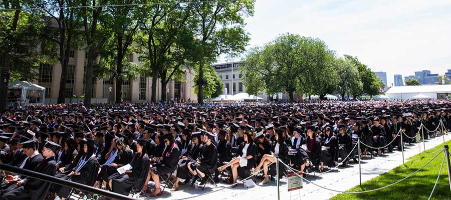 Wide shot of graduates seated in Killian Court on Commencement Day; photo: Jake Belcher