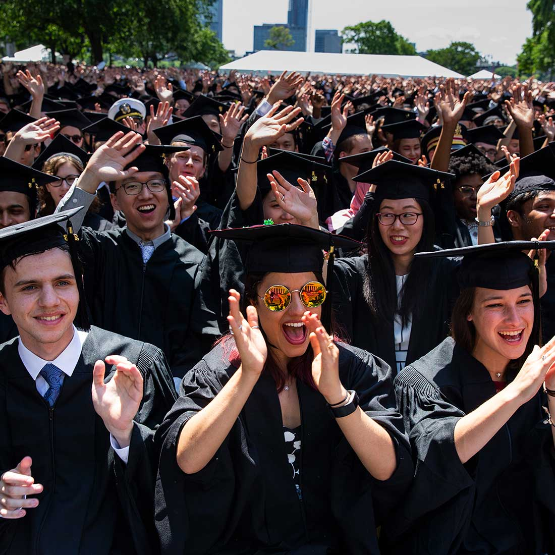 MIT graduates cheer and clap in audience; photo: Dominick Reuter